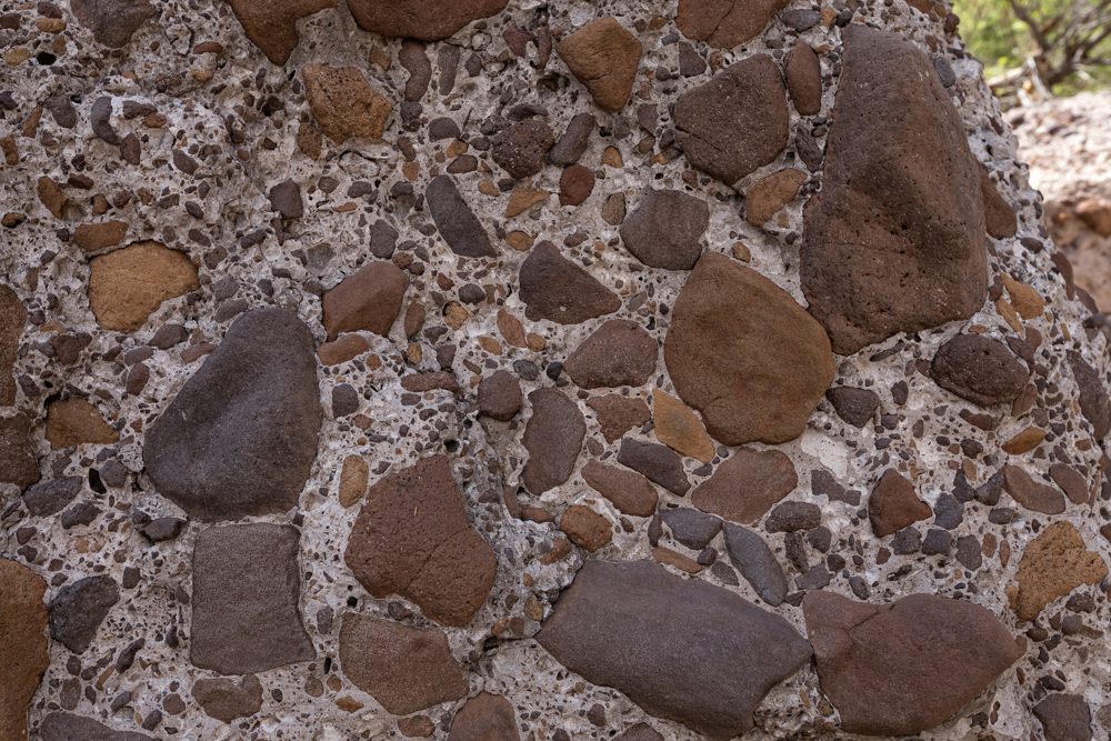 Conglomerate boulder made of smaller, rounded, igneous rocks.