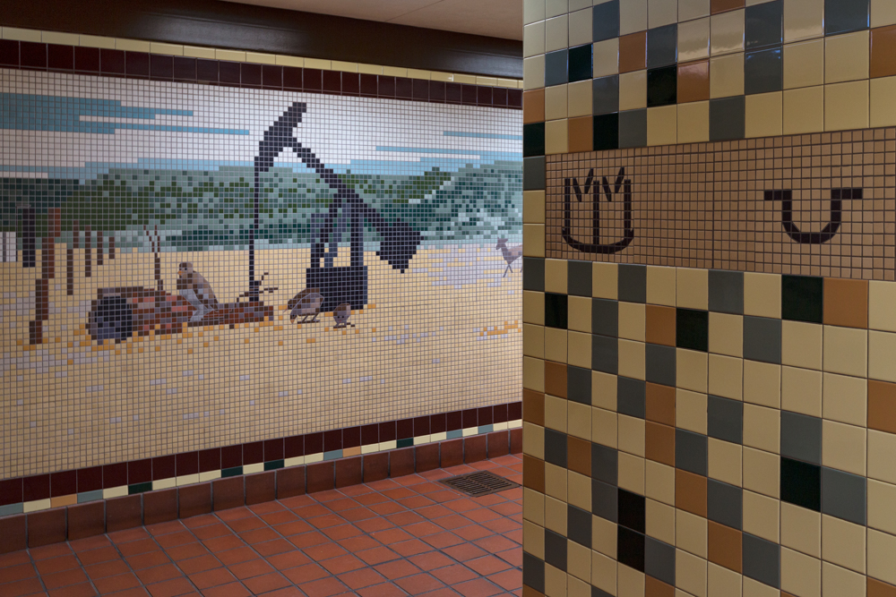 Brands and an oil rig are depicted in the Nolan County rest stop.