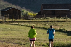 Joggers take a morning run through Fort Davis National Historic Site, Texas.